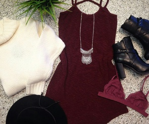 black hats, burgundy dress, and silver necklaces image
