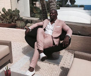 style, pink suit, and terry crews image