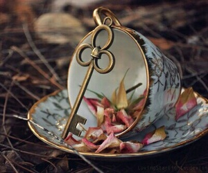 key, cup, and flowers image