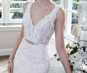 bridal gown, v-neck, and wedding dress image