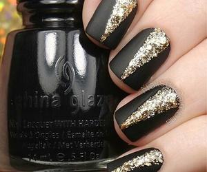 black, gold, and matte image
