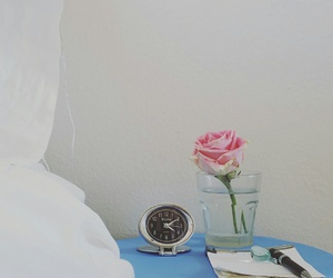 bed, clock, and flowers image