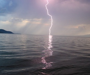 sea, lightning, and sky image