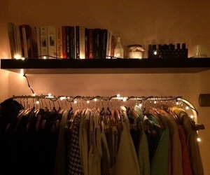 wardrobe, books, and clothes image