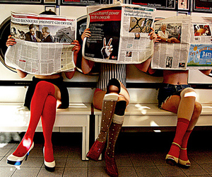 girl, news paper, and socks image