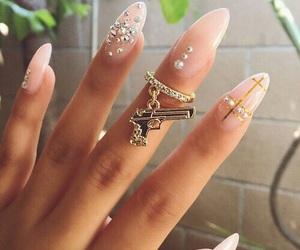 nails, gold, and gun image
