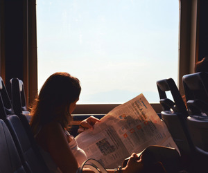 girl, travel, and reading image