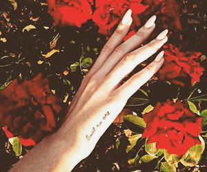 lana del rey, tattoo, and flowers image