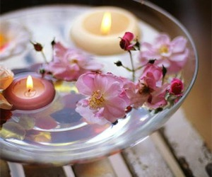 candle and flowers image
