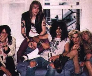 axl rose, duff mckagan, and slash image