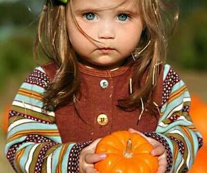 baby and pumpkin image