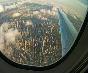 city, plane, and sky image