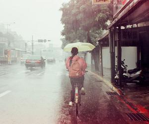 bike, rain, and umbrella image
