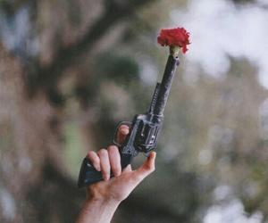 gun, flowers, and rose image