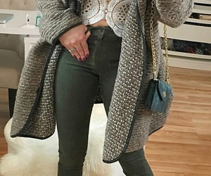 grey coat, green purse, and green jeans image