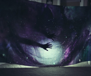 hands, stars, and galaxy image