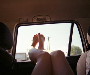 car, feet, and legs image