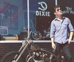 alex turner, arctic monkeys, and bike image