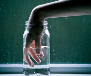 hand, water, and jar image