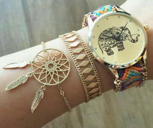 bracelet, watch, and elephant image
