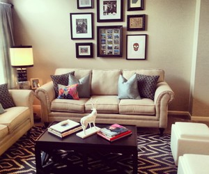 carpet, paintings, and pillows image