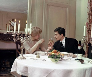 Alain Delon, couple, and dinner image