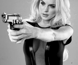 lindsay lohan, gun, and black and white image