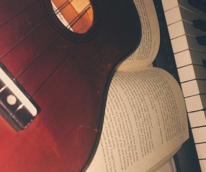 background, books, and guitar image
