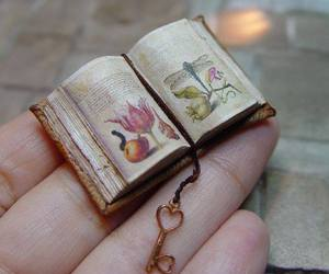 books, drawings, and miniature books image