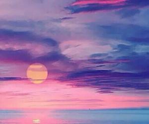 sunset, sun, and sea image