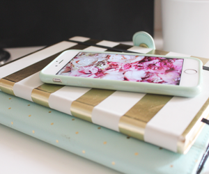 iphone, book, and flowers image