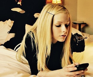 Avril Lavigne and bed image