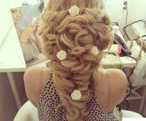 perfect for a bride and very elegant hair style image