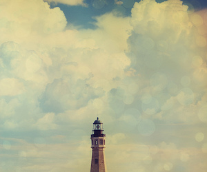 clouds and lighthouse image