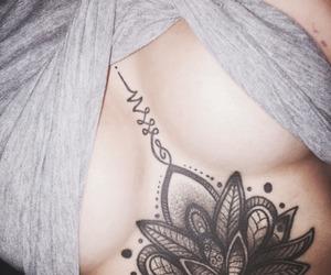 lotus, sternumtattoo, and underboob tat image