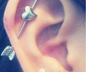piercing, heart, and arrow image