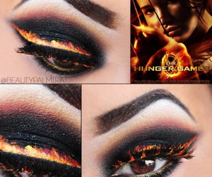 makeup, fire, and hunger games image