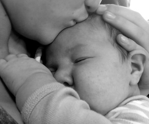 baby, cuddling, and black and white image