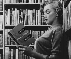 Marilyn Monroe, book, and black and white image