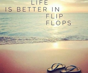 'flip flops and sea and sand' image
