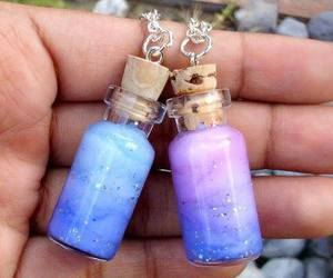 bottle, blue, and galaxy image