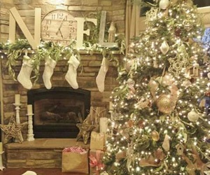 christmas tree, ornaments, and fireplace image