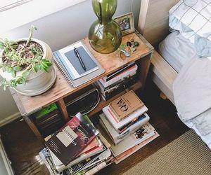 books, decor, and nightstand image