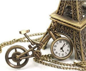 bicycle, clock, and eiffel image