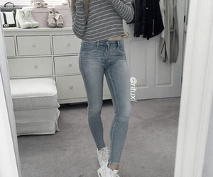 big mirror, white sneakers, and jeans image