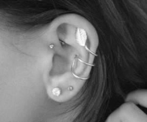 ear, earrings, and piercing image