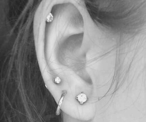 black and white, brunette, and ear piercings image