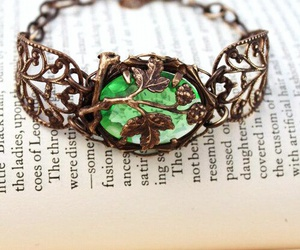 book, emerald, and jewelry image