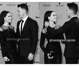 Arsenal, boy and girl, and red carpet image