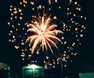 dark, fireworks, and gold image